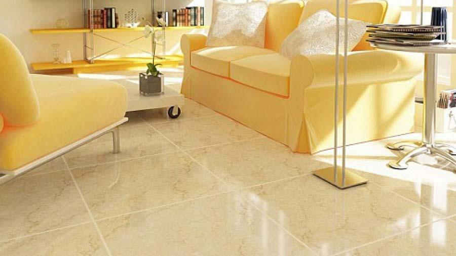 Gạch lát nền phòng khách tông vàng đất cho gia chủ mệnh Thổ.