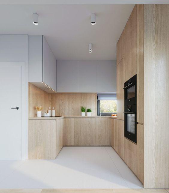 tủ bếp kết hợp hài hòa giữa màu trắng và vật liệu gỗ của tủ bếp và sàn trần