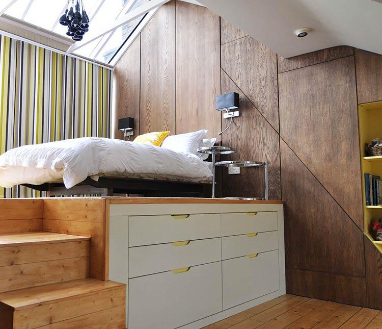 Giường cách sàn một độ cao được dùng để thiết kế tủ lưu trữ