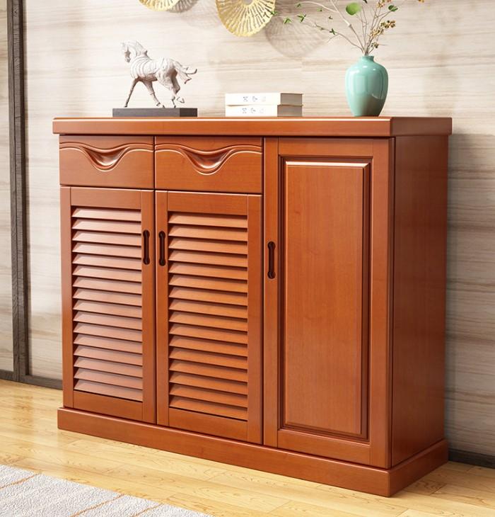Tủ giày làm bằng gỗ óc chó tự nhiên kết hợp đặt thêm nhiều đồ vật khác